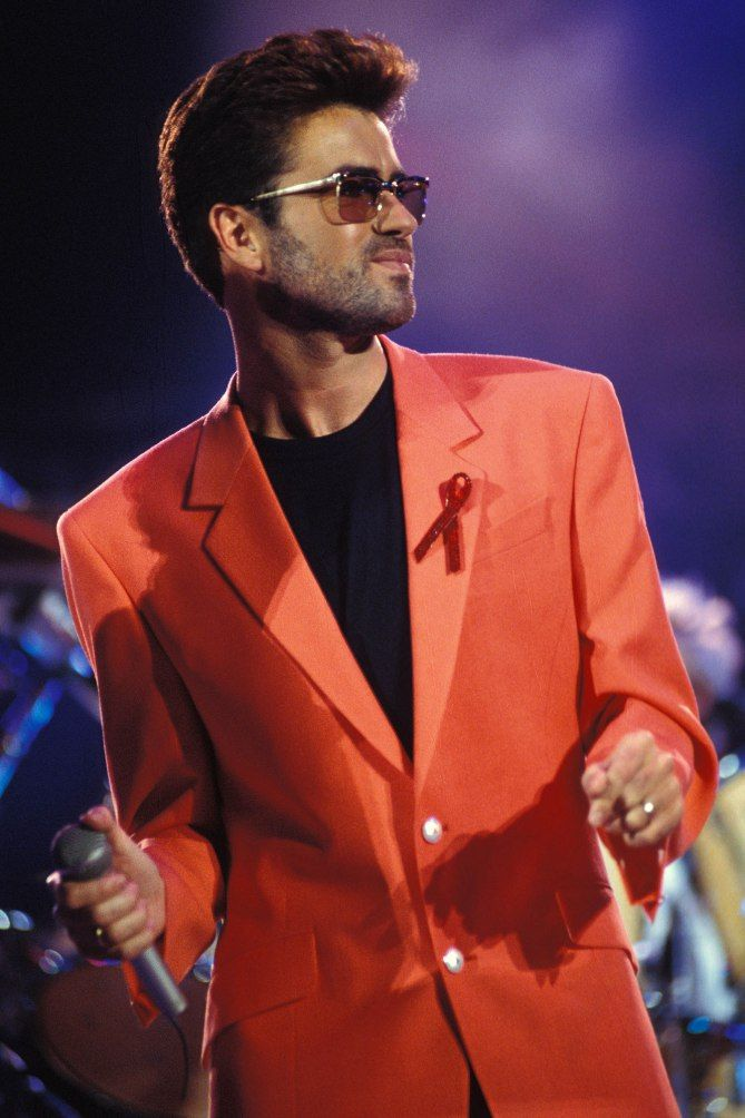 1992, a long-time AIDS activist, Michael performed at the Freddie Mercury Tribute Concert for AIDS Awareness in a bright orange blazer with a red ribbon on his lapel