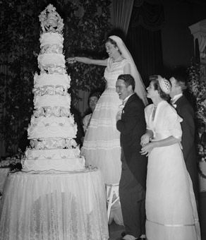 Who: Eunice Mary Kennedy & Robert Sargent Shriver, Jr.  When: 1953  1,700 guests were in attendanceat the couple's wedding ceremony at St. Patrick's Cathedral in New York City. The reception followed at the Waldorf Astoria's Starlight Roof where the bride had to be perched on a stepladder to cut the first slide of her wedding cake.