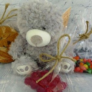 This pressie pack includes a gorgeous fluffy teddy bear, two bags of scrummy lollies and a luxury cookie.  http://littlepressie.com.au/store/teddy-lolly-cookie-combo/
