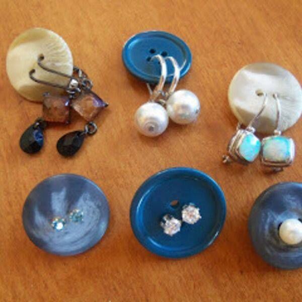 Anyone traveling this summer?  Here's a fun travel trip:  Use buttons to store your earrings in your jewelry bag to keep pairs together. Brilliant idea, isn't it?