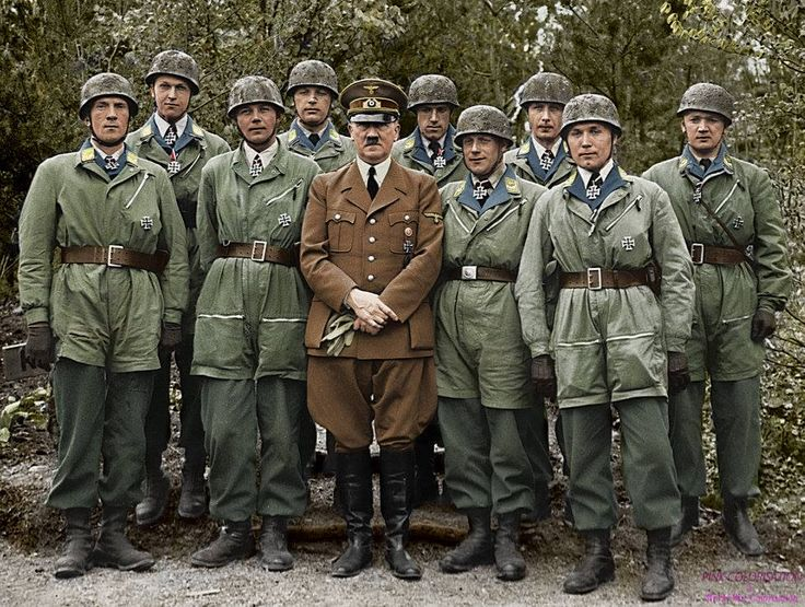 "Chancellor Adolf Hitler with a group of paratroopers (fallschirmjäger ""green devil"") decorated with the Iron Cross for having breached the Belgian fort of Eben Emael, Belgium May 1940."