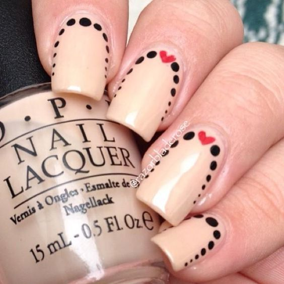 So cute! Heart and polka dot nail design.