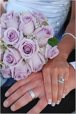 Good idea for a picture to show both your rings and the bouquet. This couple is actually sitting on the beach after the wedding and the bride is sitting between the groom's legs and leaning back against him