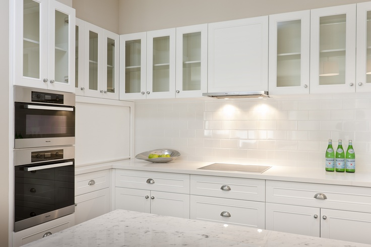 Use overhead cabinets to maximise storage space.