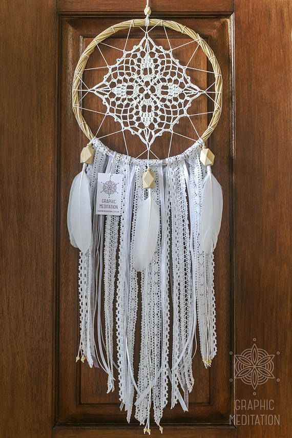 This white doily dreamcatcher will make a great decorative touch to any space, such as living room, bedroom or nursery. It will perfectly fit for white wedding decor. The same time it can be an ideal gift for a birthday or in any other occasion.  • Diameter - 10 (26cm) | Length - 28 (71cm) not including hanging ribbon. • The doily lace is individually knitted from 100% cotton • The hoop is hand made from bamboo rods • Various carefully selected vintage ribbon and lace hang from the bottom •…
