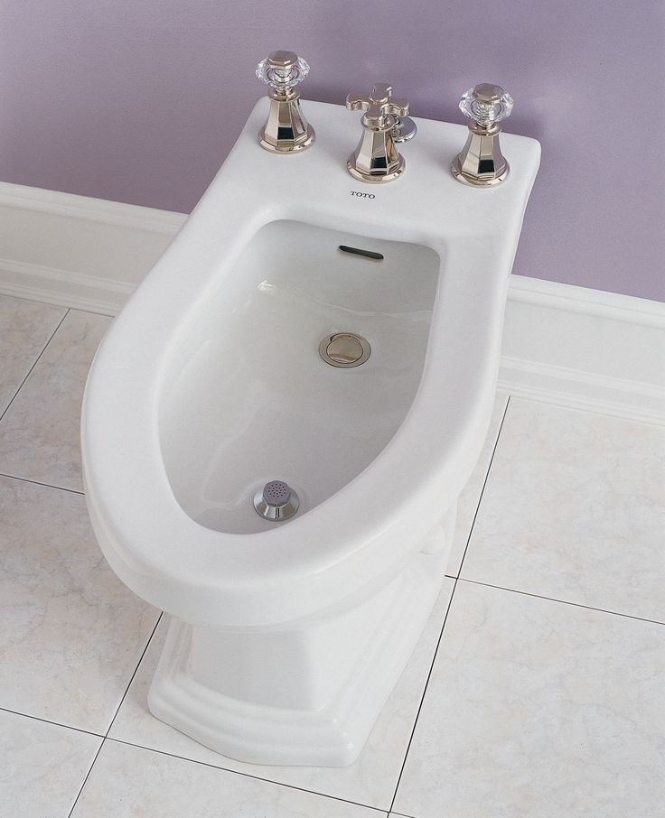 Traditionally designed, this bidet features flushing rim and integral overflow, which captures water before it can spill over.