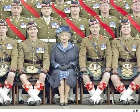 oops - to the left of the Queen, front row ... just in case you ever questioned the fact that men wear ziltch under their kilts :-)