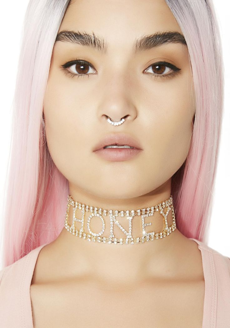 """Honey Rhinestone Choker will have them wanting to get a taste of your neck. This pretty choker features gold crystal rhinestones that spell out """"honey."""""""