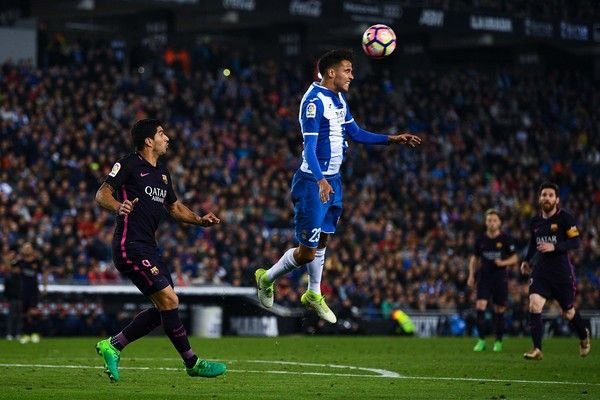 Luis Suarez of FC Barcelona competes for the ball with Diego Reyes of RCD Espanyol during the La Liga match between RCD Espanyol and FC Barcelona at the RCDE Stadium on April 29, 2017 in Barcelona, Catalonia.