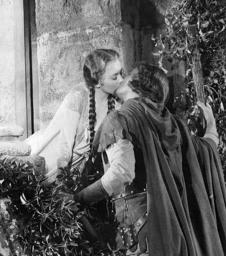 One of the best movie kisses ever. Errol Flynn & Olivia de Havilland in The Adventures of Robin Hood (1938).