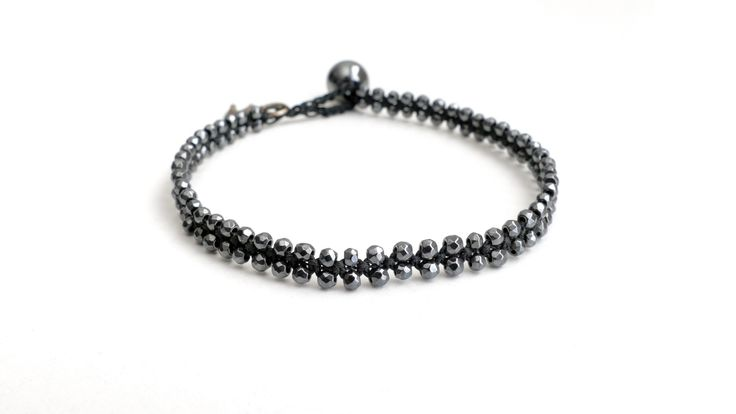 Double macrame bracelet from grey faceted Hematite -Price:27€
