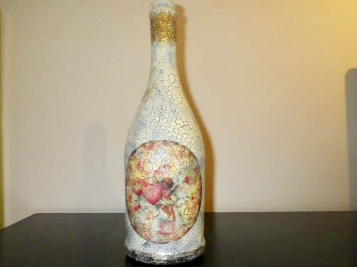 Bottle with decoupage and crackle