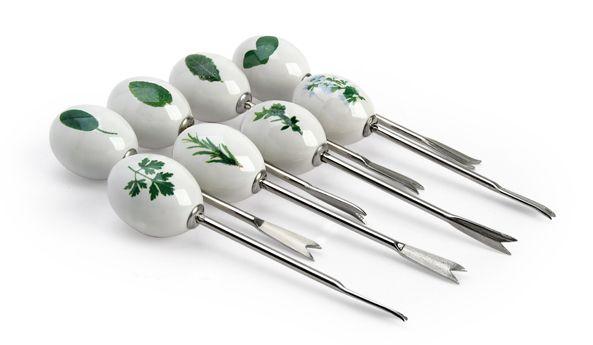 Set di 8 forchettine con pomello in ceramica decorato.