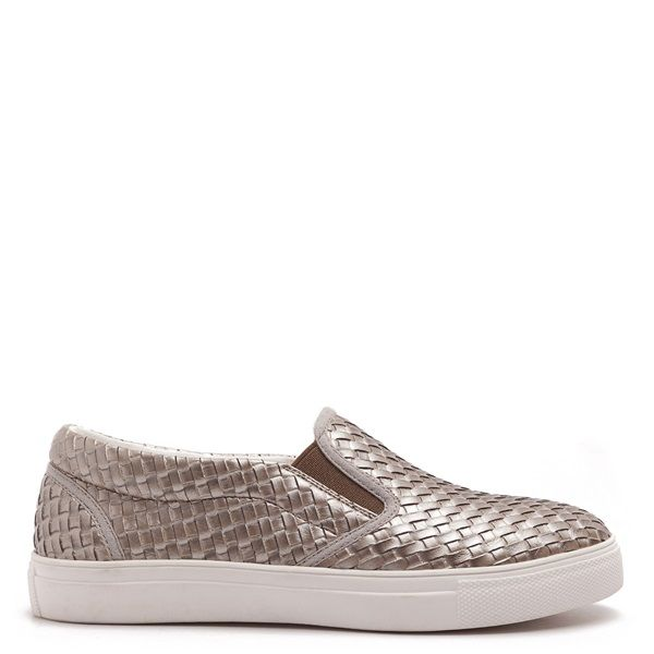 Gold coloured slip-on sneakers with matte woven texture and white sole.