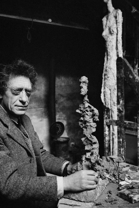 Rene Burri. FRANCE. Paris. 14th arrondissement. 1960. Rue Hippolyte Maindron. Alberto GIACOMETTI, Swiss painter & sculptor, at his studio.