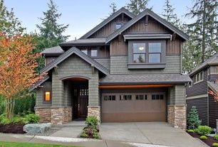 Craftsman Exterior of Home with Glass panel door, Exterior brick siding, Painted shingle siding, Raised beds, Fence