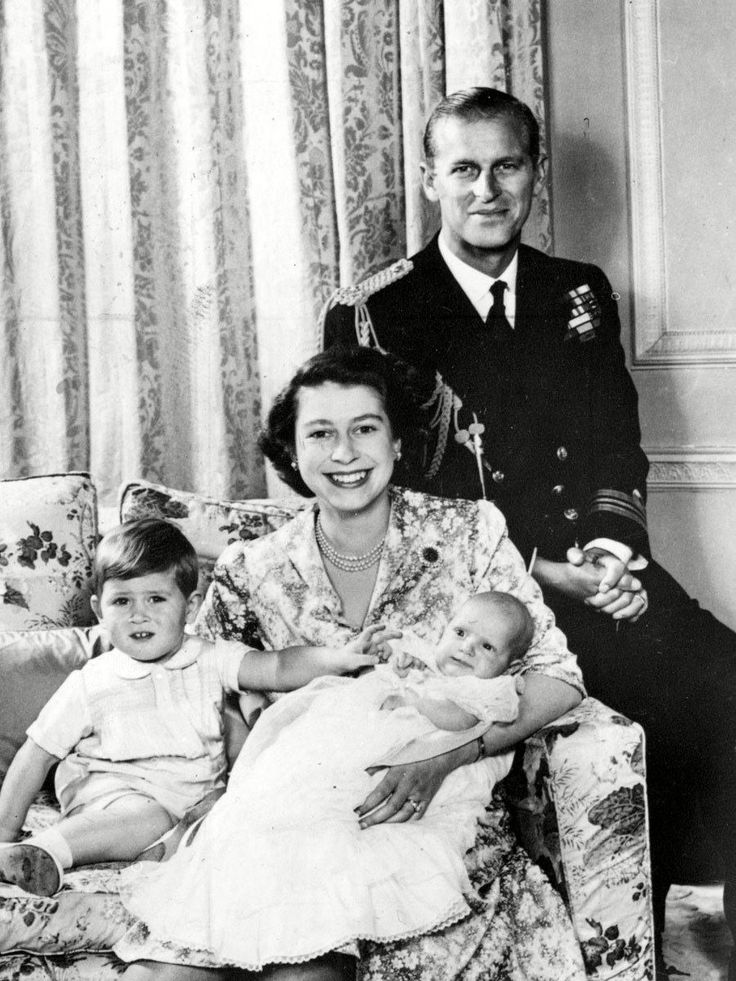 Jumping back a generation, Queen Elizabeth II looks overjoyed as she poses for a family portrait with Prince Philip and their children, Prince Charles and Princess Anne, in 1951.