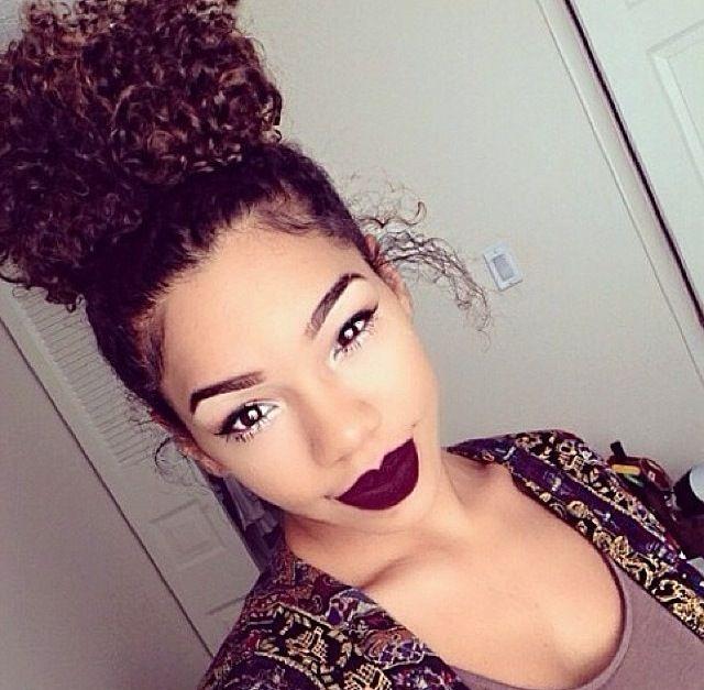 Naturally curly hair bun makeup