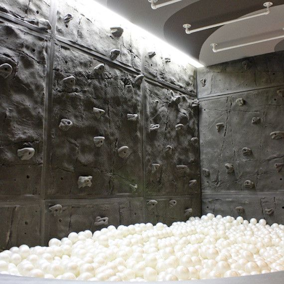 Such a cool rock climbing wall in a Rec Room.  Complete with ball pit!