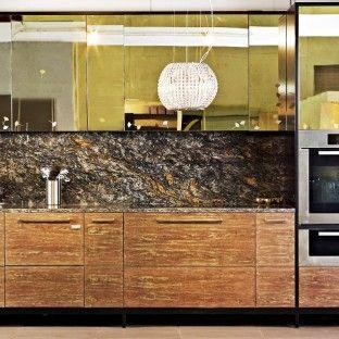 Golden veneer freestanding kitchen designed by Candi Kitchens
