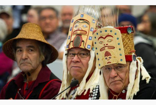 Haisla First Nation Chiefs Clifford Smith, left, Rod Bolton and Sam Robinson look on while addressing the panel during the opening day of he...