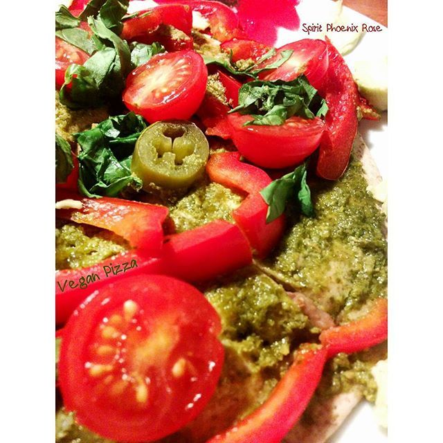Inspired by a #vegan #pizza recipe on YouTube by Karma Love, I made a version with what I already had: Tortilla spread with refried beans, Tabasco and oregano, topped with another tortilla, spread with vegan pesto, nooch, chopped cherry tomatoes, red bell pepper, spinach, jalapeño; into a mid-heat oven, center shelf for about 5 minutes, served with avocado: #NOMS. #SpiritPhoenixRose 👻🔥🌹
