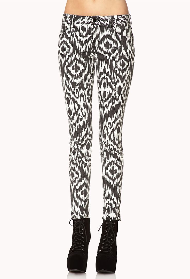 Patterned jeans are super cute and really stylish. I absolutely love the pattern on these ones. Patterned jeans look good with solid tops paired with either a long necklace or scarf. Then to go with it plain boots or sneakers.