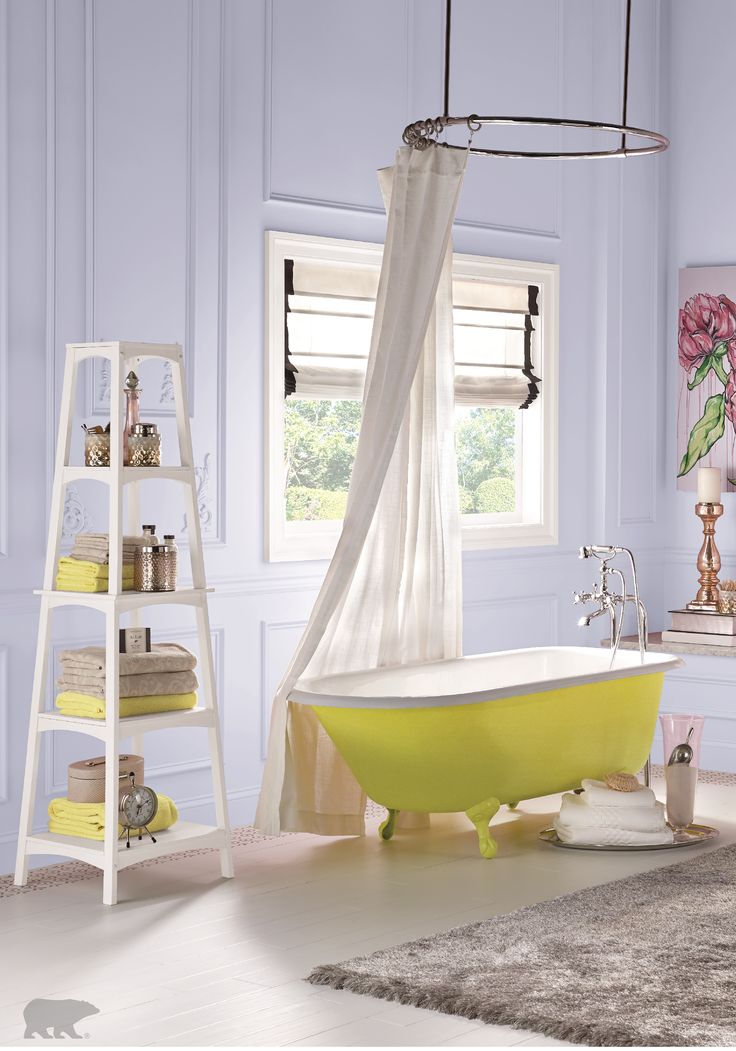 this beautiful white bathroom is perfected with a yellow painted clawfoot tub try adding pops of bright color to rooms with white wall colors for a