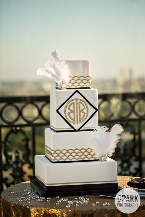 Elegant luxurious ivory champagne gold black feather Great Gatsby art deco inspired wedding cake on city skyline The Rooftop by Gordon Ramsay at the London West Hollywood Hotel wedding