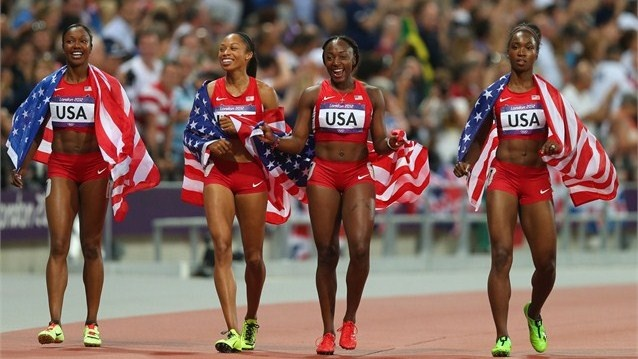 United States celebrate after winning gold and setting a new world record of 40.82 in the women's 4 x 100m Relay