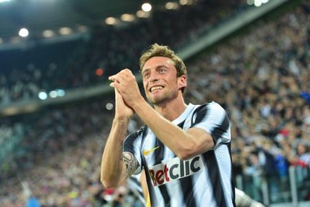 Senyuman selebrasi Marchisio setelah mencetak gol di menit 8
