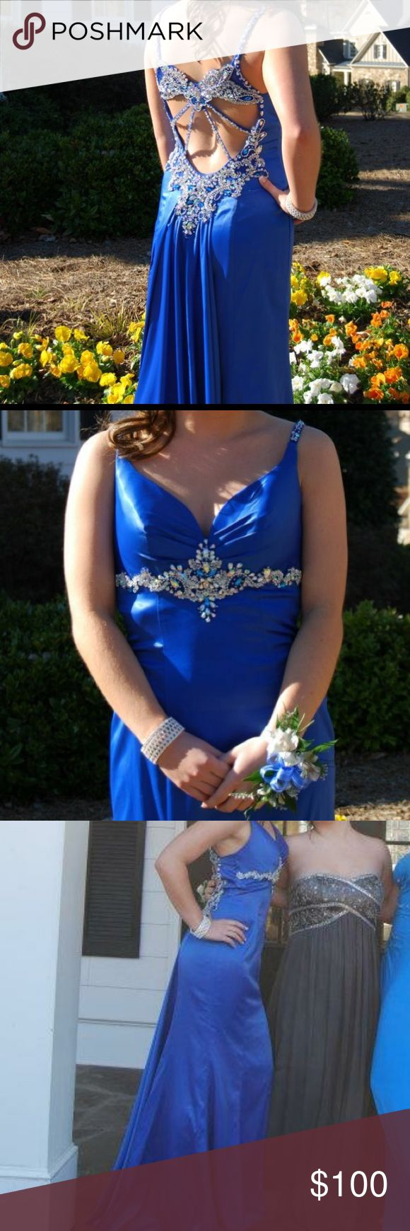 PROM DRESS!! This dress was $450 when I bought it. It is a beautiful, beautiful dress. The detailing is just amazing. There are a few gems missing (as seen in pictures), but a seamstress could easily fix it. It is a size 4, only the length was altered to hit the floor just right on my 5'4 frame with 3 inch heals. Dresses Prom