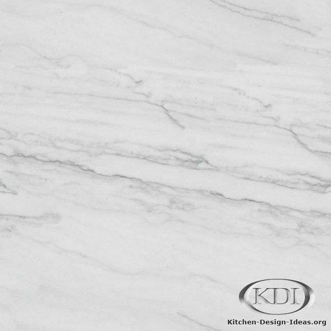 Classic White Quartzite, more durable than Carrara Marble. Need to check this out in person to judge the look.