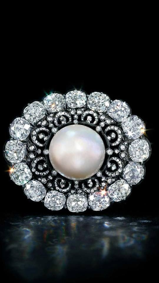 The Putilov pearl and diamond brooch C1900  I'm in awe of those cushion cut diamonds!!! Just incredible! #DiamondBrooch #DiamondBrooches