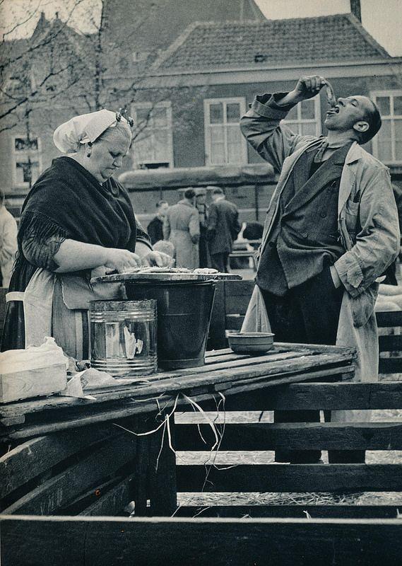 Kees van Wijk-  Den  Haag   scheveningse visverkoopster 1957 - Fresh Herring at the dock.