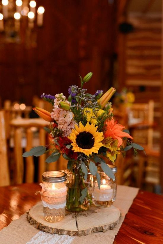 Country Style Sunflowers Wedding Centerpiece / http://www.himisspuff.com/rustic-wedding-centerpiece-ideas/9/