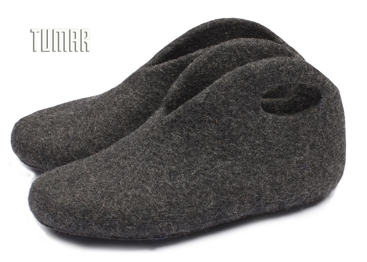Ankle slippers. Felt - 100% wool. Handmade, solid-rolled. Technique - resist felting + perforation. Sole - synthetic felt + silicone protector. Color: grey mélange. Catalogue: Going Wild, 2016. Tumar Art Group.
