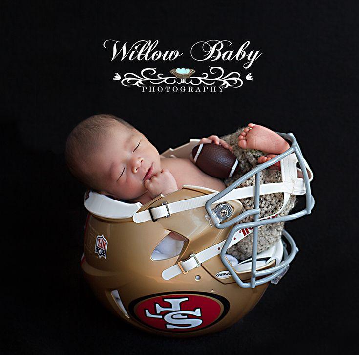 Newborn photo of baby in 49ers helmet newborn in helmet www willowbabyphotography com newborn