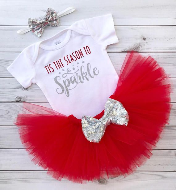 This listing is for the adorable Tis The Season To Sparkle Tutu Outfit. The set includes: bodysuit or shirt, red tulle tutu, and silver sequin bow on white elastic or alligator clip. The bodysuit/t-shirt is pre-washed in an all natural detergent, and then heat pressed with red and