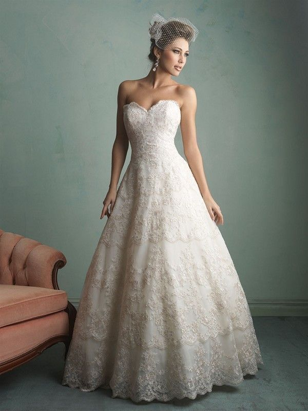 Superb  this gown features patterned all over lace and a strapless sweetheart neckline The soft ballgown silhouette makes this gown ideal for any bride