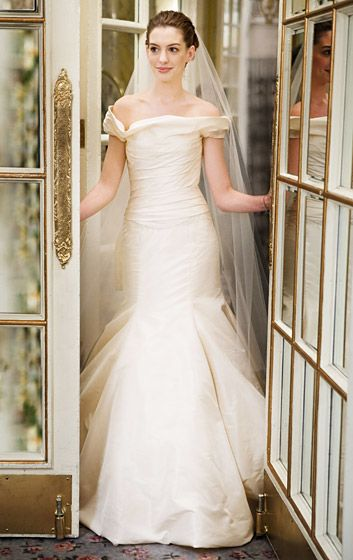 "Anne Hathaway in 2009's Bride Wars, Hathaway's Emma Allan wore an off-the-shoulder taffeta dress by Vera Wang when she and Fletcher Flemson (Chris Pratt) said ""I do."""