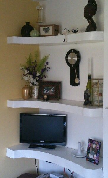 Boxed and curved shelving to fit alcove