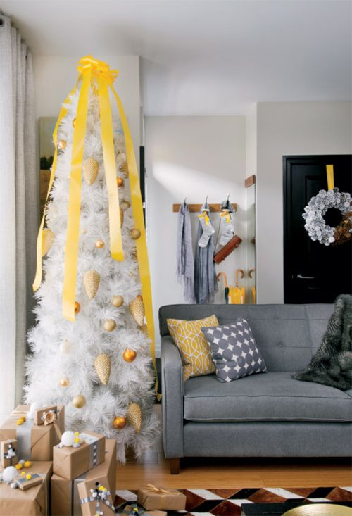 a perfectly coordinated Christmas...yellow and grey...a different look but matches the home decor.....