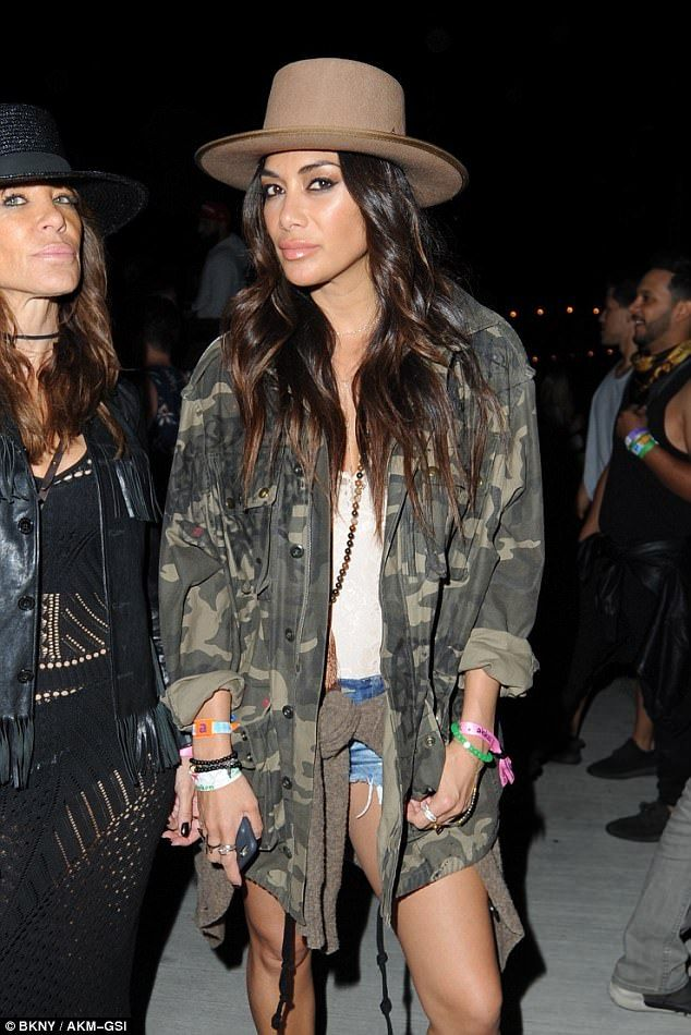 So chic: Nicole Scherzinger cut a stylish figure as she stepped out in California at Coachella on Saturday night in a pair of thigh-skimming denim hot pants, shortly before ex Lewis Hamilton pined for her on Snapchat