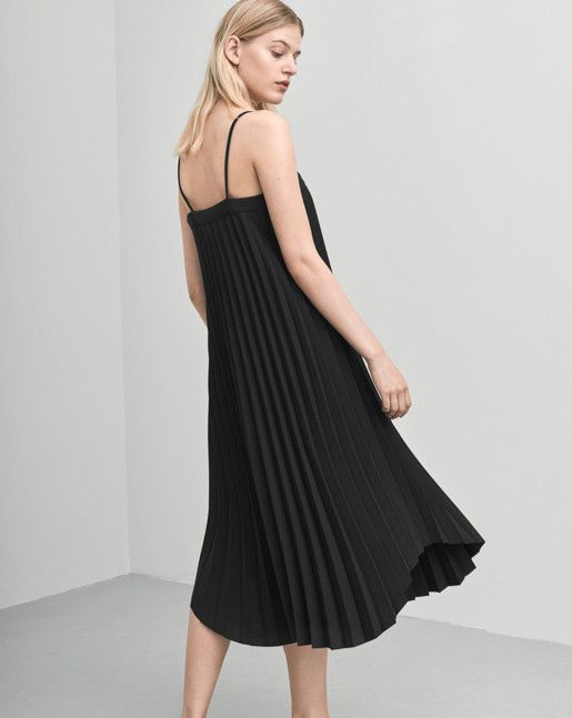 A strap dress in a luxurious and graphic, heavy plissé. Slightly shaped bottom. Under the knee length.  <br><br> - Heavy tick plissé<br> - Shaped bottom<br> - Under knee length<br><br>  The model is 175cm and wears size S.