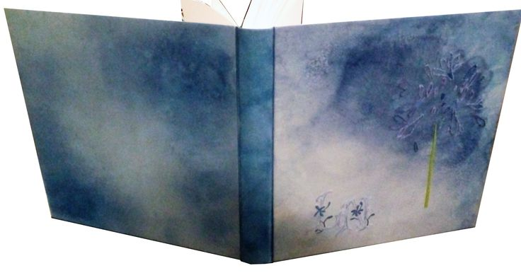 Unique handmade photo album. Bound by Evangelia Biza in June 2016. For the book block is used CONQUEROR / WOVE HIGH WHITE 300 gr paper. The cover is made of leather which was painted in the colors of agapanthous. Embroidered monogram and flower petals,with cotton and silk threads.