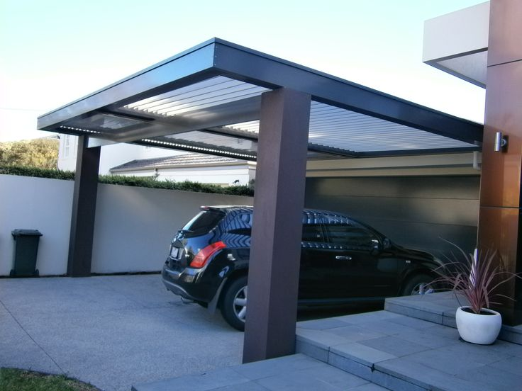 Stylish Double Louvre Roof Carport that retains natural light with protection from the weather.