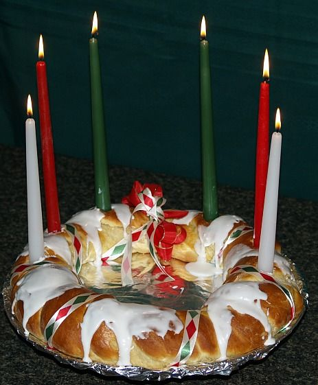 Learn how to make holiday bread recipes. This wreath bread comes from Sweden. It is called St. Lucia Day Wreath. This is a sweet bread baked on a baking sheet.