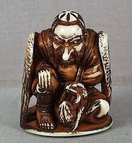 TENGU KING & wrestling toads // 19th century ivory netsuke of Sojobo - the tengu king - seated on a cushion and watching 2 toads wrestling by his knee. Tengu are mythological creatures half men, half birds, usually depicted as goblins, and are first-class fighters.