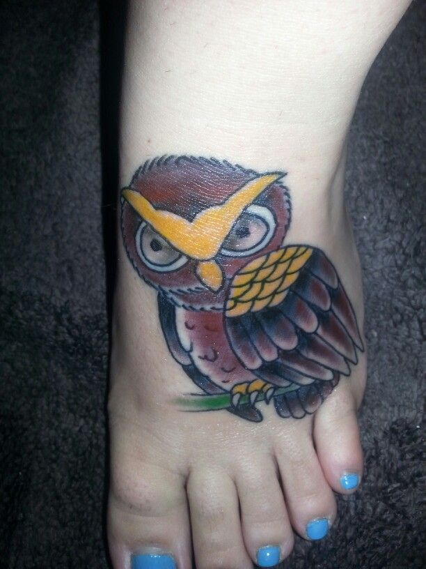 Traditional owl foot tattoo